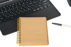 smartphone, laptop computer and memo note with ballpoint pen - stock photo