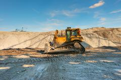 Excavation site with construction machine Stock Photos