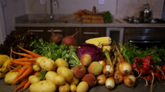 Organic fruits and vegetables in the kitchen, slider to the rigth, wide Stock Footage