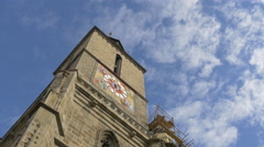The Black Church clock tower on a blue sky background, Brasov Stock Footage