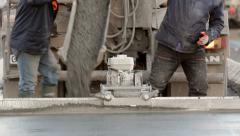 Cement truck pouring concrete into a parking construction for aircrafts - stock footage
