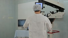 Man using a big microscope system in a medical laboratory Stock Footage