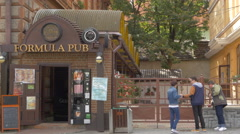 The entrance of Formula Pub restaurant, on Heroes Boulevard, Brasov Stock Footage
