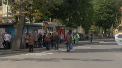 People waiting for the bus and buying bus tickets, on a street in Brasov Stock Footage
