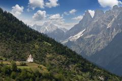 Caucasus mountines with wiew to small church near Mestia direct to Chalati ga Stock Photos