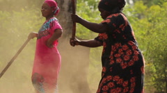 African ladies manually working the land Stock Footage