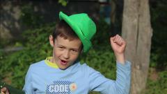 Boy jumping, gesturing, having fun, good mood Stock Footage