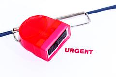 Red urgent stamp on white paper with rubber stamper and clipboard. - stock photo