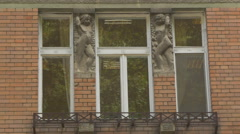 Bas-relief sculpture on a brick building in Brasov Stock Footage
