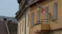Flag of Romania waving on a building in Brasov Stock Footage