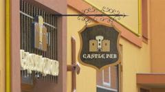 Castle Pub sign in Brasov Stock Footage