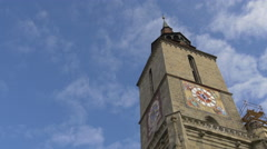 Beautiful clocks on each facade of the Black Church tower, Brasov Stock Footage