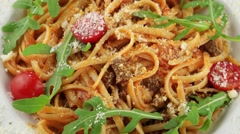 Spaghetti Bolognese with cherry tomatoes (loop) - stock footage