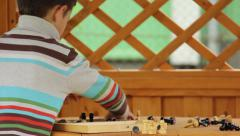 Boy folding chess, board with chess retracting Stock Footage