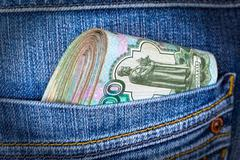 Folded Russian rouble bills in the back jeans pocket Stock Photos
