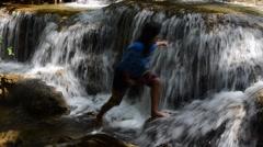 Thai women playing Kroeng Krawia Waterfall Stock Footage