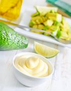 Avocado and sauce Stock Photos