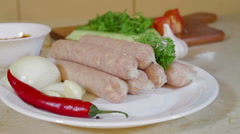 Bratwurst sausages, onion, chili pepper,vegetables Stock Footage