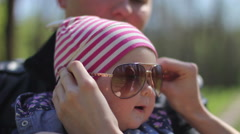 Funny girl in her mother's glasses Stock Footage