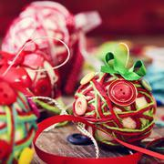 Handmade christmas balls, made with, cords, ribbons and buttons Stock Photos
