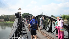 People travel and walking at the Bridge of the River Kwai Stock Footage