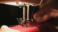 Sewing process in the phase of overstitching, close up Stock Footage