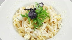 Penne pasta with four kinds of cheese (loop) Stock Footage