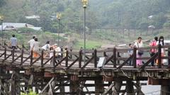 People travel and walk on Saphan Mon wooden bridge at Sangkhlaburi Stock Footage
