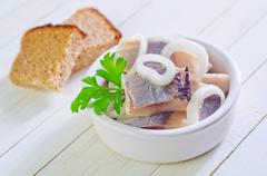 Herring with onion and bread Stock Photos