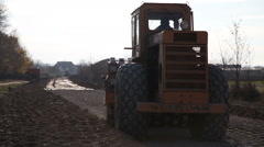 Vibratory roller on construction site Stock Footage