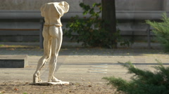 Statue without head seen on a sunny day in Bucharest Stock Footage