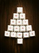 Christmas tree made of computer keys,tree background with vignette - stock photo