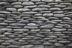Gray stone background of the old wall of pebbles - stock photo