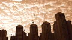 Hi Rise Buildings at Sunset at a Low Angle with Clouds. Stock Footage