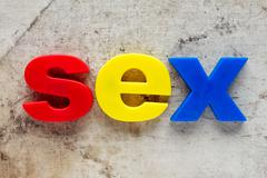 SEX spelled out using colored magnets - stock photo
