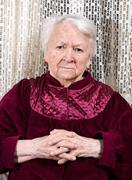 Stock Photo of Portrait of old upset woman at home