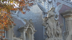 Statue of an angel with harp and two children in Bucharest Stock Footage