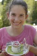 Girl with dessert StieAlm am Brauneck Upper Bavaria Bavaria Germany Europe - stock photo