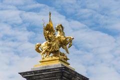 Stock Photo of Golden equestrian statue on the Pont Alexandre Paris France Europe