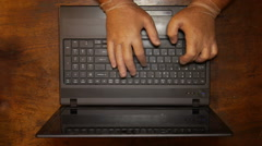 Crook thieve spy hacker criminal terrorist in laptop with latex gloves - stock footage