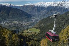 Stock Photo of Meran 2000 gondola with snowy mountains Trentino Province Province of South