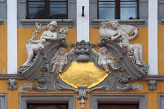 Mercury and Minerva stucco decoration on house Untermarkt 13 Gorlitz Stock Photos