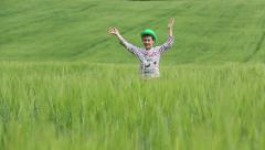 Boy Stands in Tall Grass in the Field, Waving at the Camera, Gesturing Cool Stock Footage