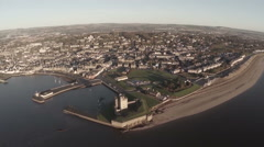 Aerial shot flying over Broughty Castle on the river tay by Dundee Stock Footage