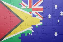 puzzle with the national flag of guyana and  australia - stock photo