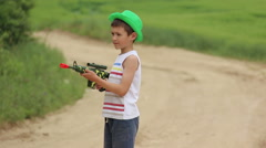 Boy with arms found the intruder and ready to shoot Stock Footage