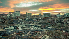 The remains of destroyed houses at sunset timelapse. Stock Footage