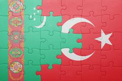 puzzle with the national flag of turkey and turkmenistan - stock photo