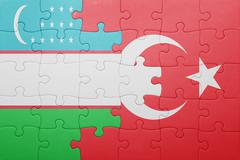 puzzle with the national flag of turkey and uzbekistan - stock photo