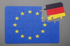 Puzzle with  flag of european union and germany piece detached. - stock photo